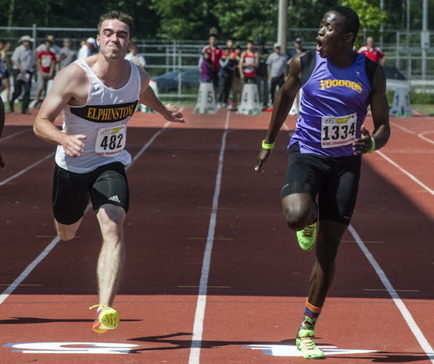 Rutland's Jerome Blake (right) tops Felix Rankin of Gibsons-Elphinstone in the senior varsity 100 metre final at the BC high school championships Friday in Langley. (Steve Bosch, PNG)