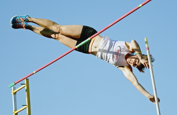 Leanna Carriere clears the bar in the pole vault during the Edmonton Track and Field Council's evening of family fun and sport to commemorate the grand opening of the new Rollie Miles Athletic Grounds on Friday May 22, 2015. Larry Wong / Edmonton Journal