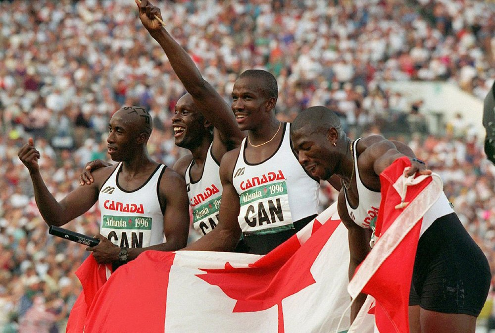 Robert Esmie on left, with Bruny Surin, Donovan Bailey and Glenroy Gilbert