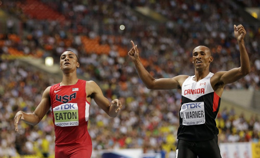United States' Ashton Eaton, left, the gold medal winner of the men's decathlon, and Canada's Damian Warner, bronze medal winner, right, celebrate at the World Athletics Championships in the Luzhniki stadium in Moscow, Russia.