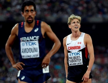 Canada's Charles Philibert-Thiboutot, right, looks at the results from a men?s 1500m semifinal at the World Athletics Championships at the Bird's Nest stadium in Beijing, Friday, Aug. 28, 2015. When Philibert-Thiboutot races the Wanamaker Mile, he'll be adding his name to one of track and field's greatest stories. THE CANADIAN PRESS/AP Photo/David J. Phillip