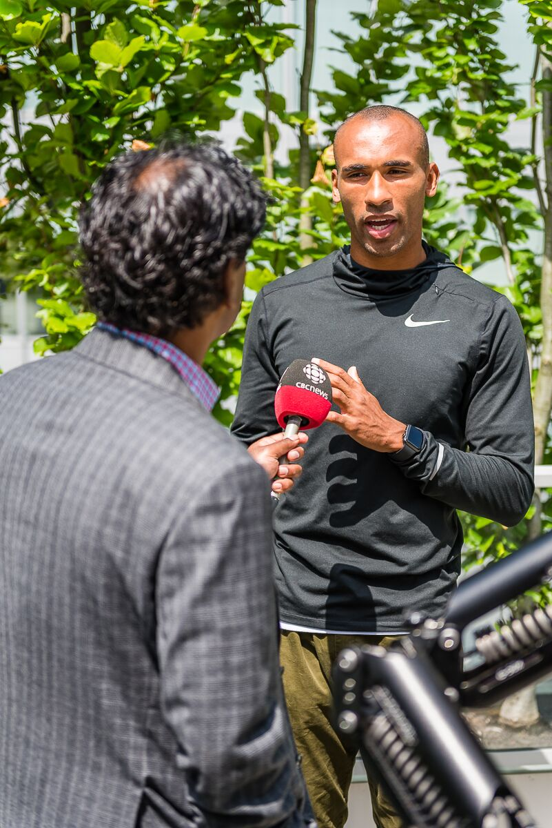 Damian Warner, Olympic bronze medalist in decathlon  with Ian Hanomansing of CBC  Photo Credit: Brian Cliff