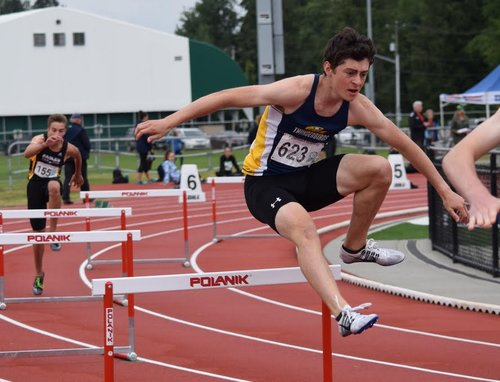 Paul Fisher running 400m hurdles