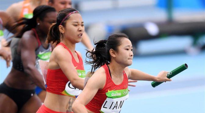 LIANG Xiaojing receives baton for Team China
