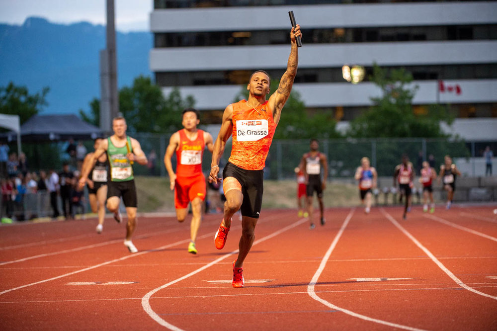 Andre De Grasse anchors Team Canada's 4x100 to new meet record photo: Allan Hay