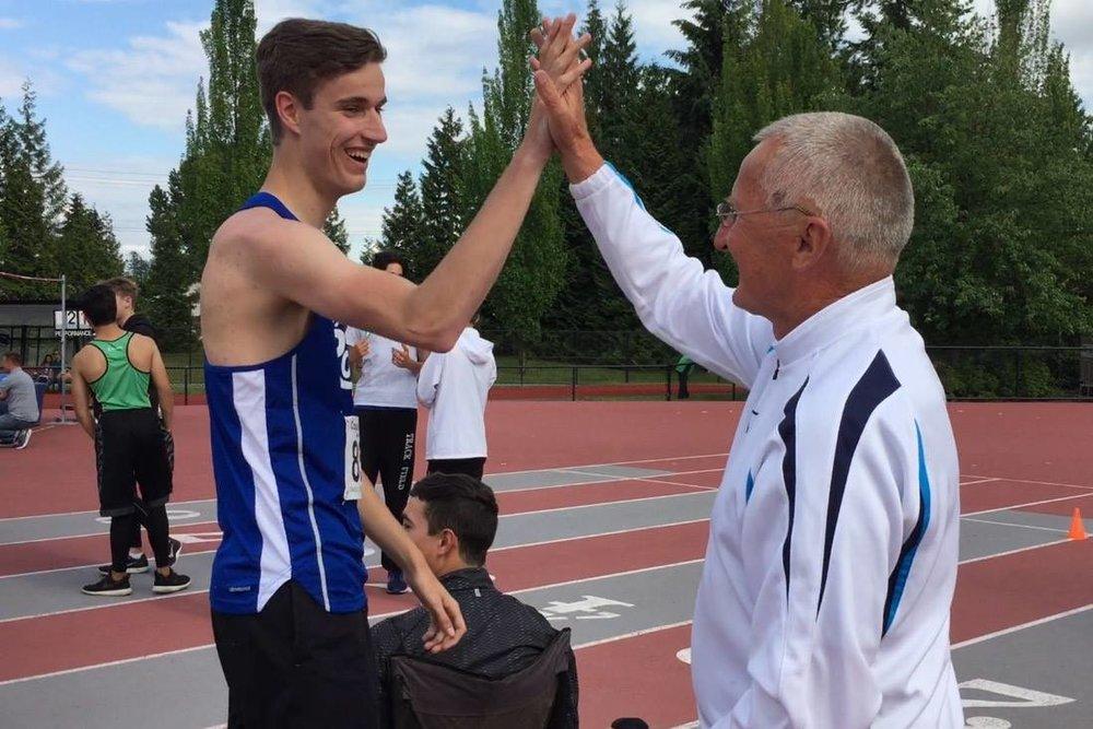 Coach Ziggy Szegalowicz congratulates Eric Chatten