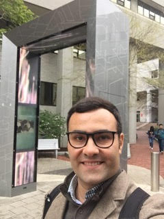 Murilo in front of a tribute to Bernard M. Gordon