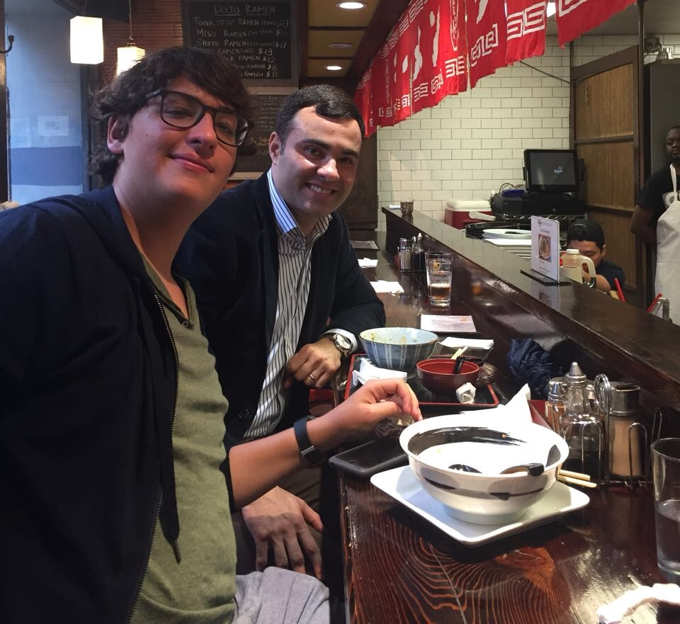 A student shows Murilo where the best food is near NYU's campus
