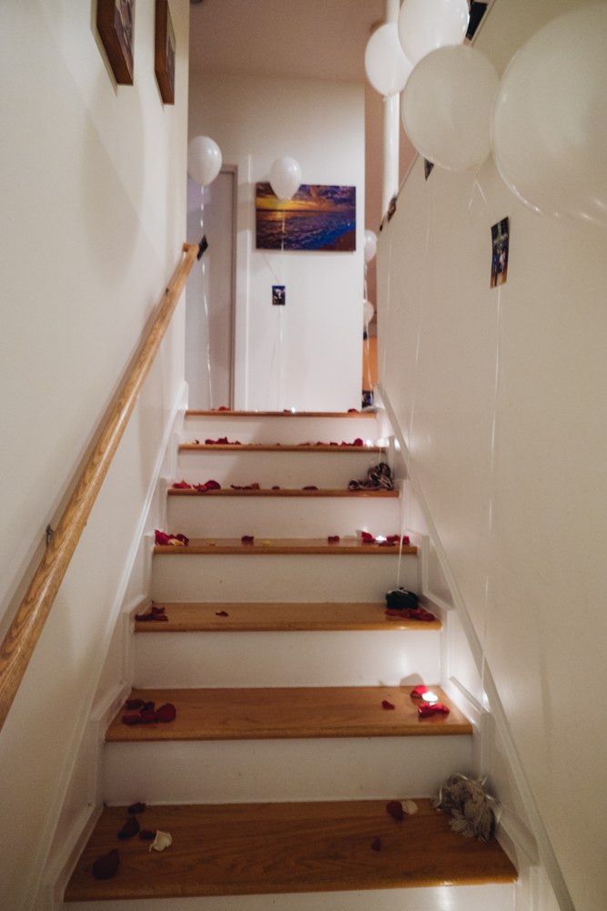 The stairwell had a few balloons, candles and rose petals leading up to the living room.