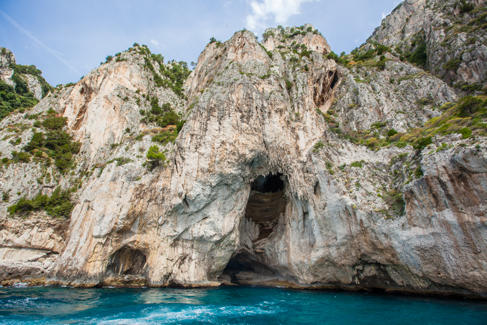 Our tour guide took us around the entire island before we docked.  Beautiful, natural caverns and grottos surround the perimeter of this island.  Another secret you'll miss if you take one of the larger commercial boats to Capri.