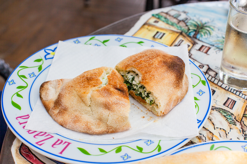 A delicious mezzaluna stuffed with spinach and ricotta.  My half was so full that the entire contents somehow made it's way to the floor :(  At least my wife shared a bite of hers.