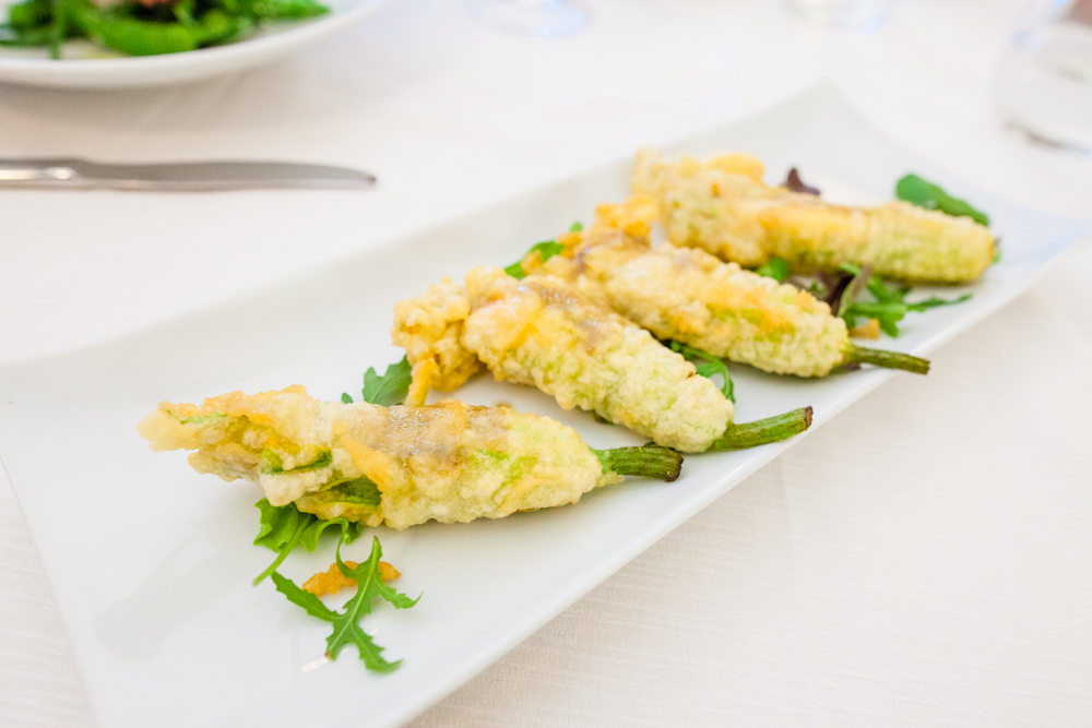 Fiore di zucca pastellato - zucchini blossoms stuffed with ricotta, butter sauce, lemon and anchovies