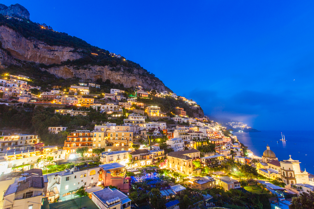 The city lights up at night, which adds to the mystical appeal of this cliffside town.