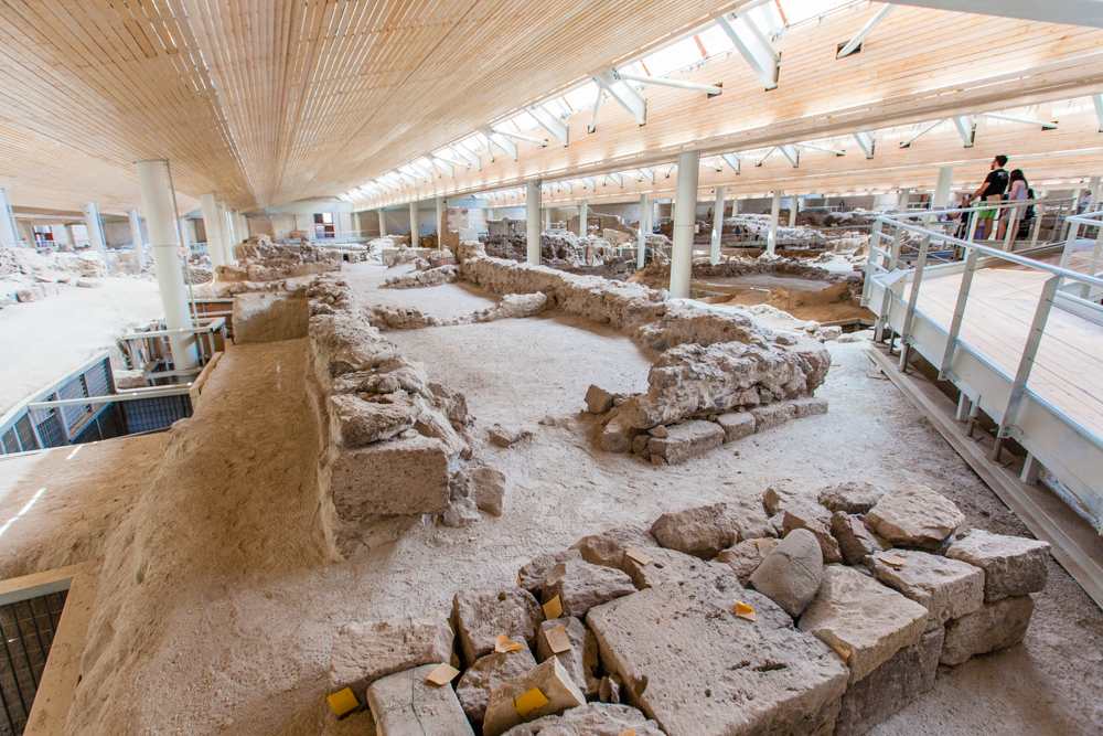 Similar to Pompeii, Akrotiri was buried in volcanic ash around 1627 BC, which preserved the remains of this Minoan Bronze Age settlement.   Akrotiri started as a small farming and fishing village, and later expanded into a center for processing copper.