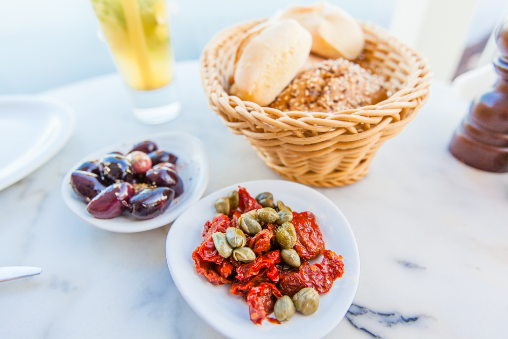 Black olives, sundried tomatoes, and capers with freshly-baked bread