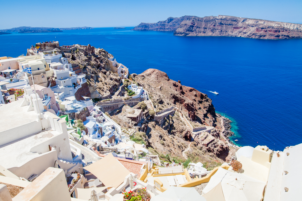 The kastro walls of Oia (ruins of an old castle that dates back to the 1200s; a popular spot to watch the Santorini sunset).  You can also see the 300 steps leading down to Amoudi Bay.