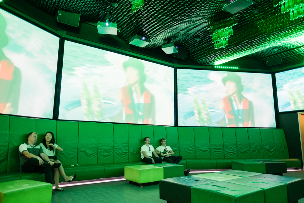 A 360-degree TV room with various Heineken commercials in different languages