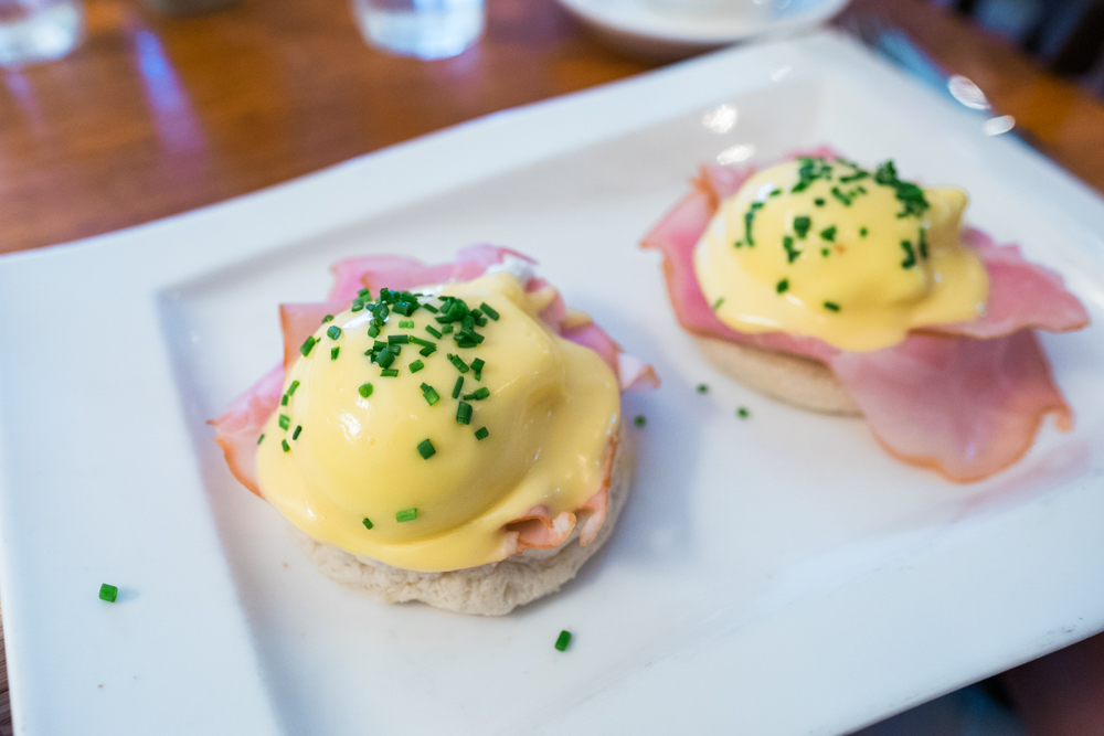 Eggs Benedict: Two poached eggs on a hot buttered muffin with smoked ham and hollandaise sauce