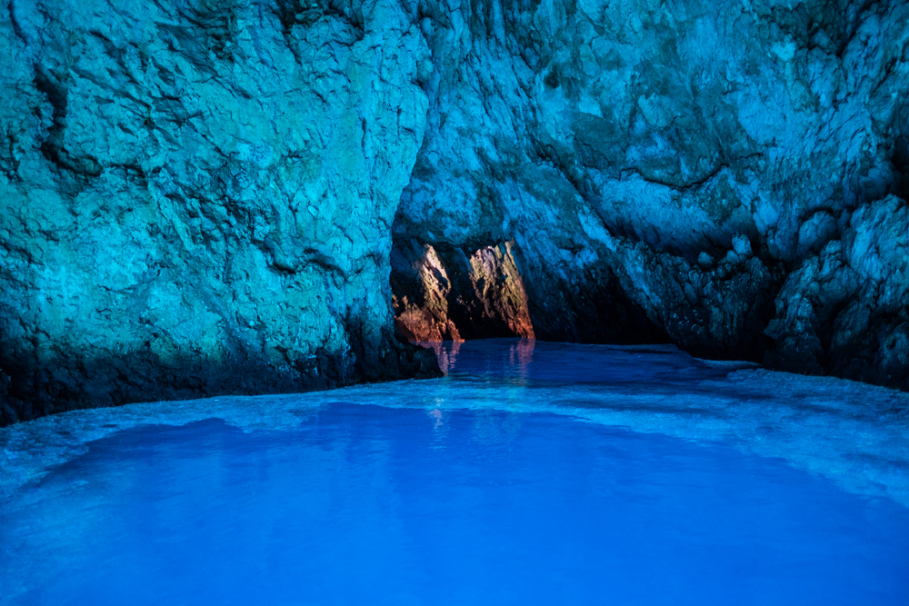 The natural glow is created entirely by sunlight, no other forms of light were present inside the Blue Cave. The water was clear enough to see the fish swimming around inside.