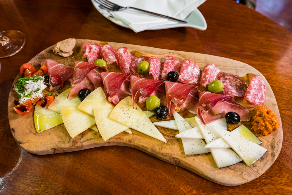 Charcuterie board made up of local meats and cheeses