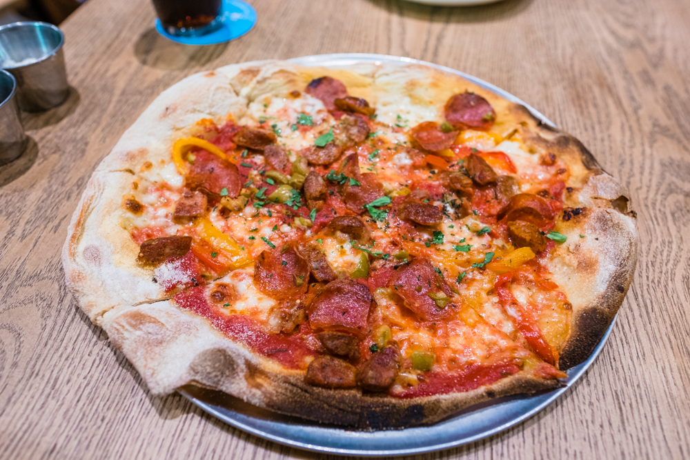 The brewmaster pizza - Kukui spicy sausage, pepperoni, roasted bell peppers, olives, red sauce
