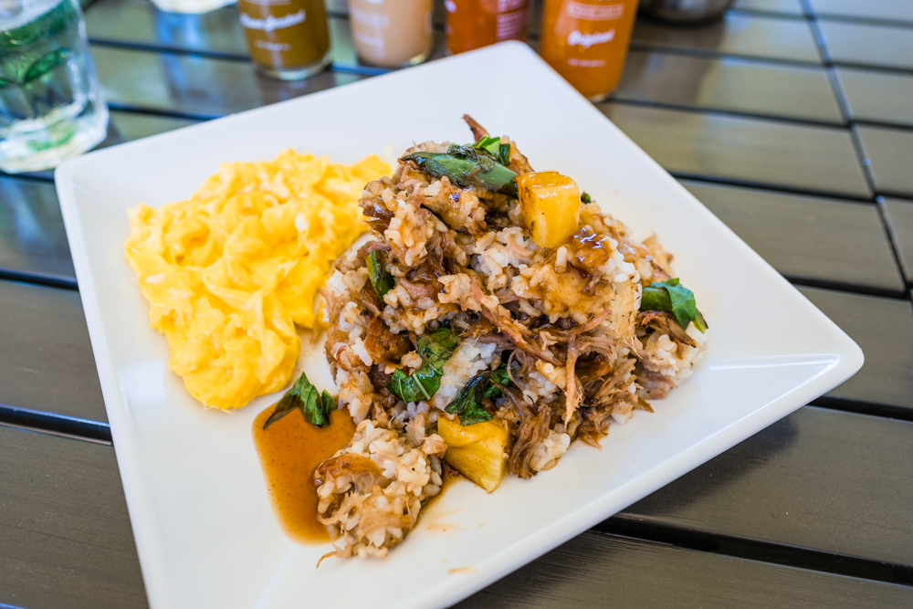 Kalua Pork Fried Rice: slow cooked Kalua pork, rice, pineapple, jalapeño, basil and two eggs topped with shoyu ginger sauce