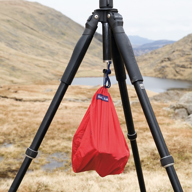 A weighted bag helps hold a sturdy Gitzo tripod in place. Credit: DPReview