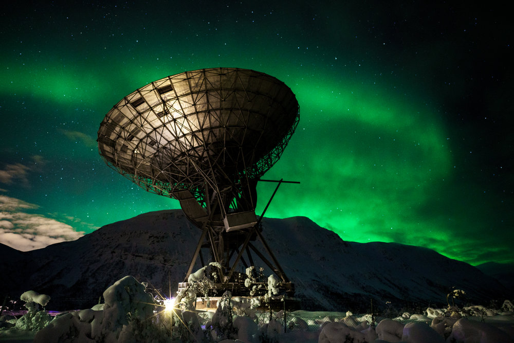 This is one of my favorite photographs taken at the EISCAT research station in Northern Norway. On this particular night the Northern Lights were not very strong, but present enough to capture some bands for a rather nice composition. Using a Zeiss 21mm f/2.8 lens on a Sony A7RII allowed me to capture all of the sky along with the dish and snow in the foreground. With the combination of a wide angle lens and fast aperture, I was able to gather enough light (to make the weaker aurora brighter) and keep the stars sharp with a shutter speed of only a few seconds.