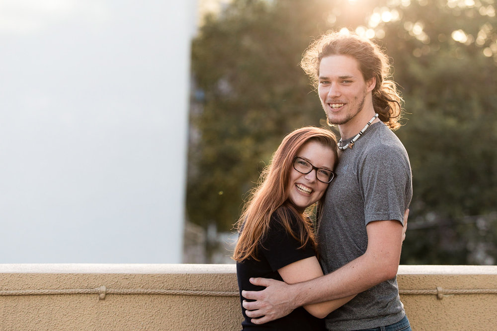 Engaged couple at sunset in downtown St. Petersburg, Florida