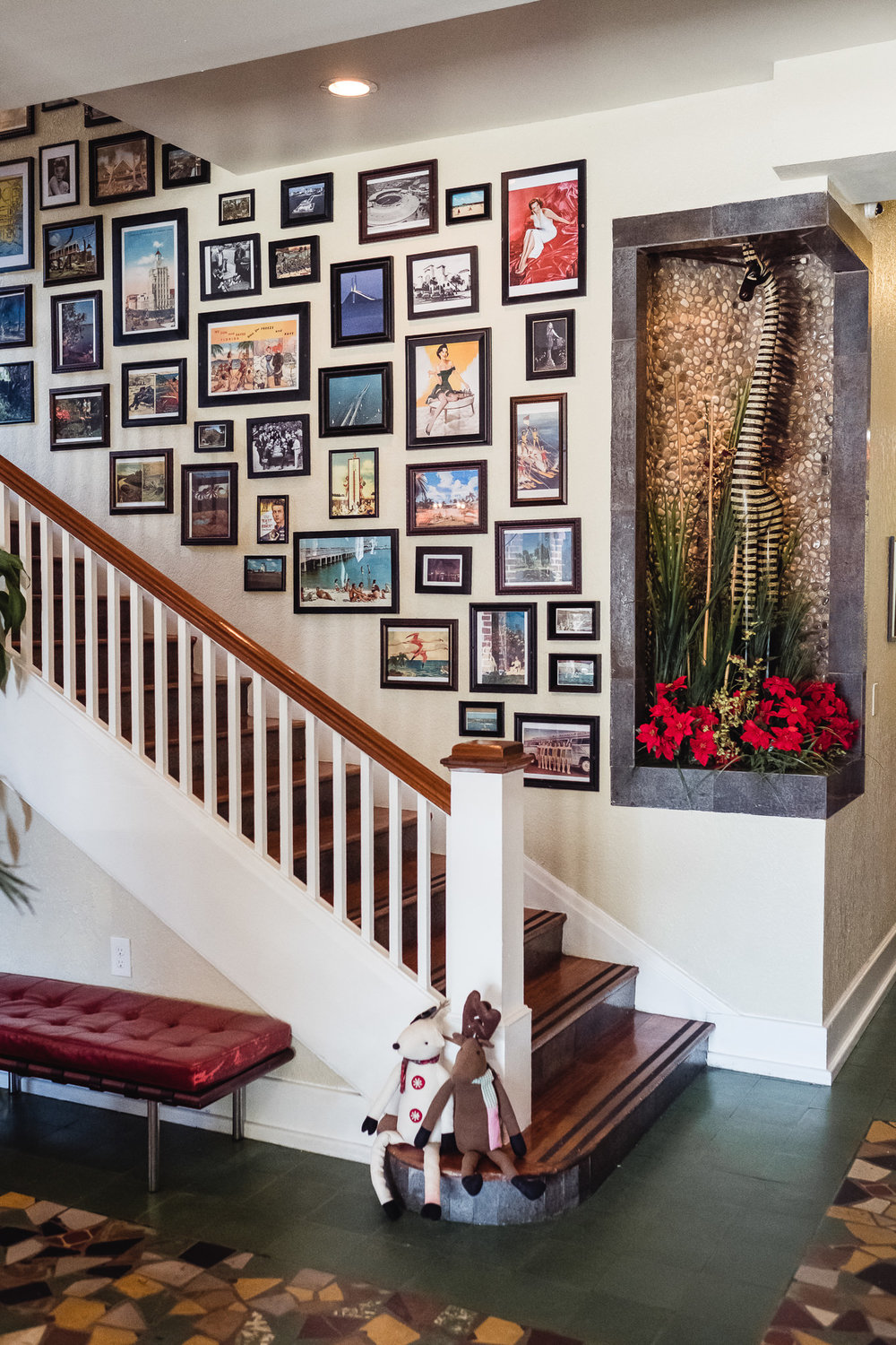 Collage of photographs lining the lobby staircase at the Hollander Hotel in St. Petersburg, Florida