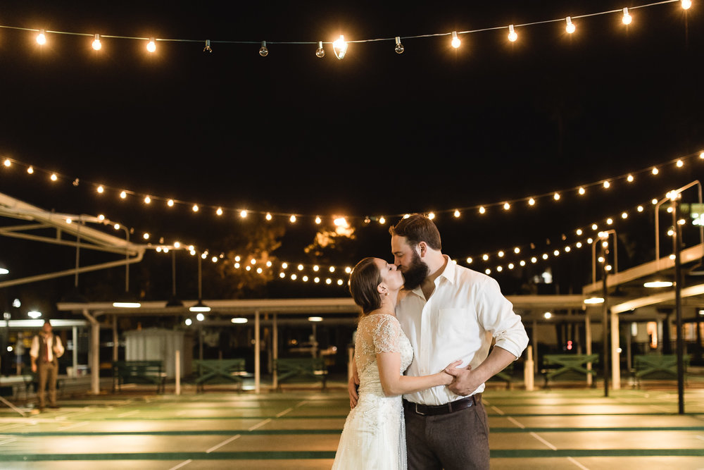 Dramatic nighttime wedding photograph of Bride and Groom at St. Pete Shuffle Wedding Portrait at the Shuffleboard Club in St. Petersburg, Florida