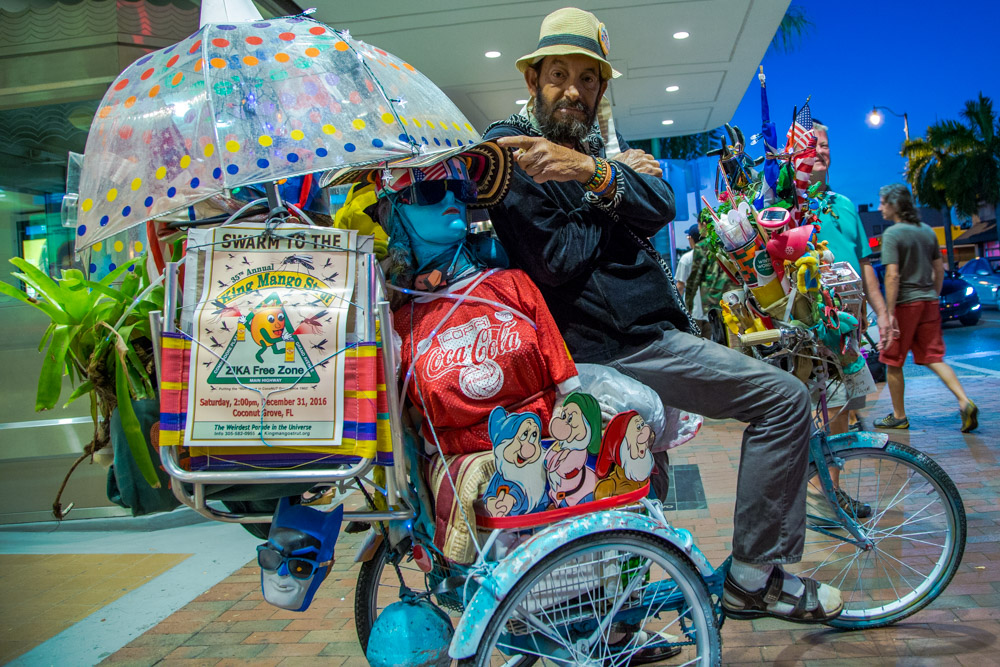 Jay, Cuban American; a Peter Pan child who is always roaming the streets of Calle 8 either riding his colorful and uniquely decorated bike or van full of objects from Cuban and American cultures.