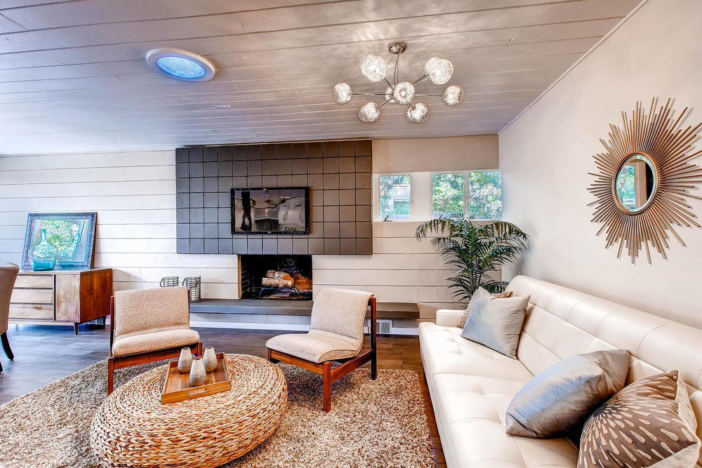 Plenty of seating space in this living room.  The cinder block walls & wood ceilings are found not only in most edward hawkins homes, but also in many mid-century modern homes.