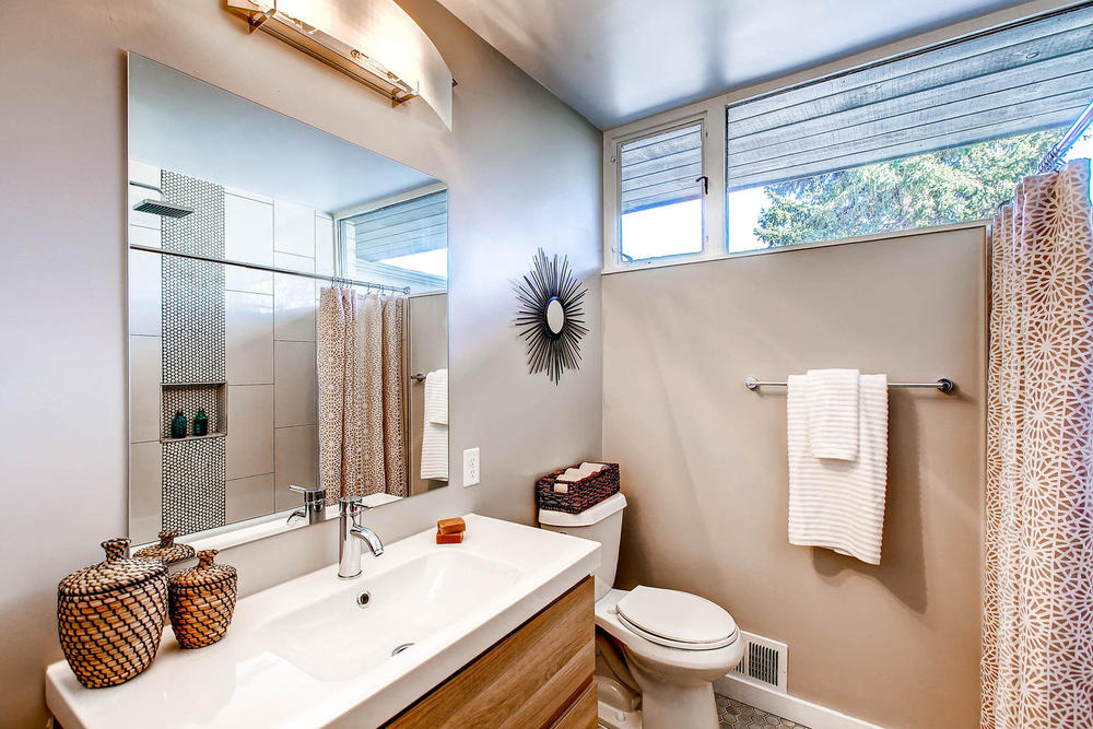 This main bathroom features what is likely the original cast iron bathtub, with other classic updates.