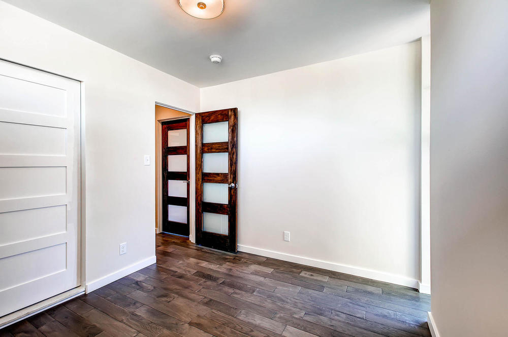 The seller updated the bathrooms and bedrooms  with custom mahogany  doors that feature frosted glass panels.