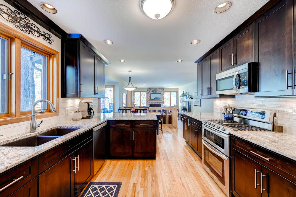 This impressive kitchen was recently remodeled in 2013, with high-end finishes throughout.