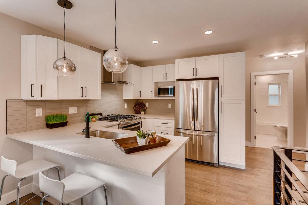 1051 Newport Street Denver CO-013-26-Kitchen-MLS_Size.jpg
