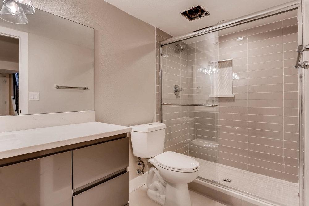 1051 Newport Street Denver CO-023-4-Lower Level Bathroom-MLS_Size.jpg