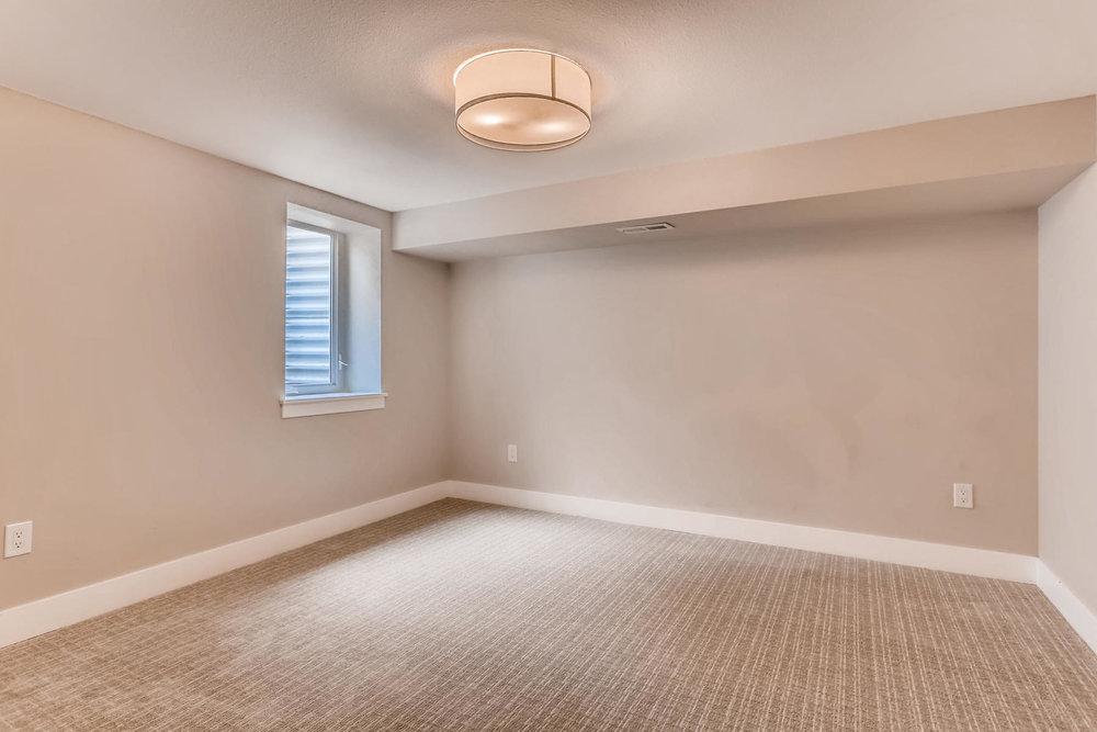 1051 Newport Street Denver CO-024-2-Lower Level Bedroom-MLS_Size.jpg