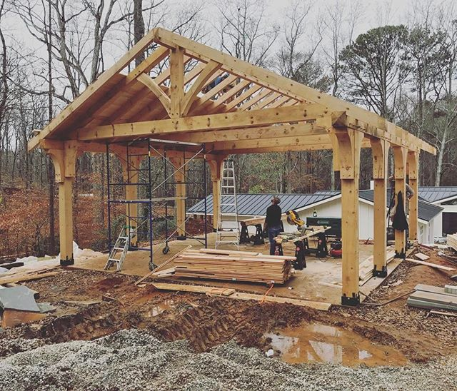 We are making head way on this timber frame parking structure with mortise and tenon joinery. It is looking quite nice in front of this complete remodel we have been working on. Pictures of the house to come.  #customhome #remodel #homebuilder #generalcontractor #timbers #timberframe #mortiseandtenon #marietta #georgia #cobbcounty #underconstruction