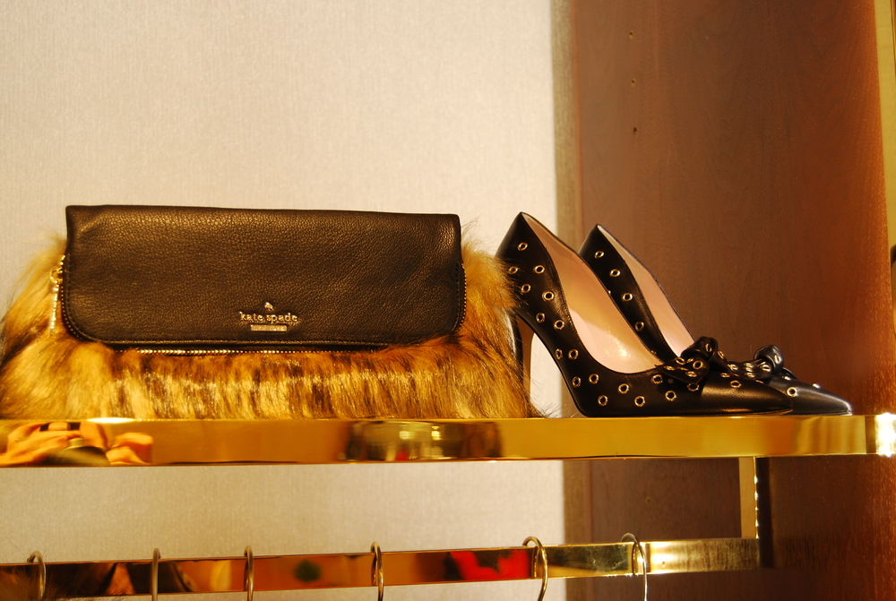 Gorgeous faux fox clutch & killer black riveted pumps.  Elegant and edgy.