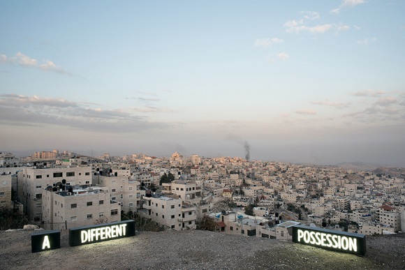 A DIFFERENT POSSESSION, Three on-location custom made light boxes, Looking onto Palestinian  Village Issawiyah, annexed by Israel in 1967, from Mount Scopus, Jerusalem, 2014, Digital C print, 27X40 / 40X60 inches, Shimon Attie, courtesy of Jack Shainman Gallery, NY
