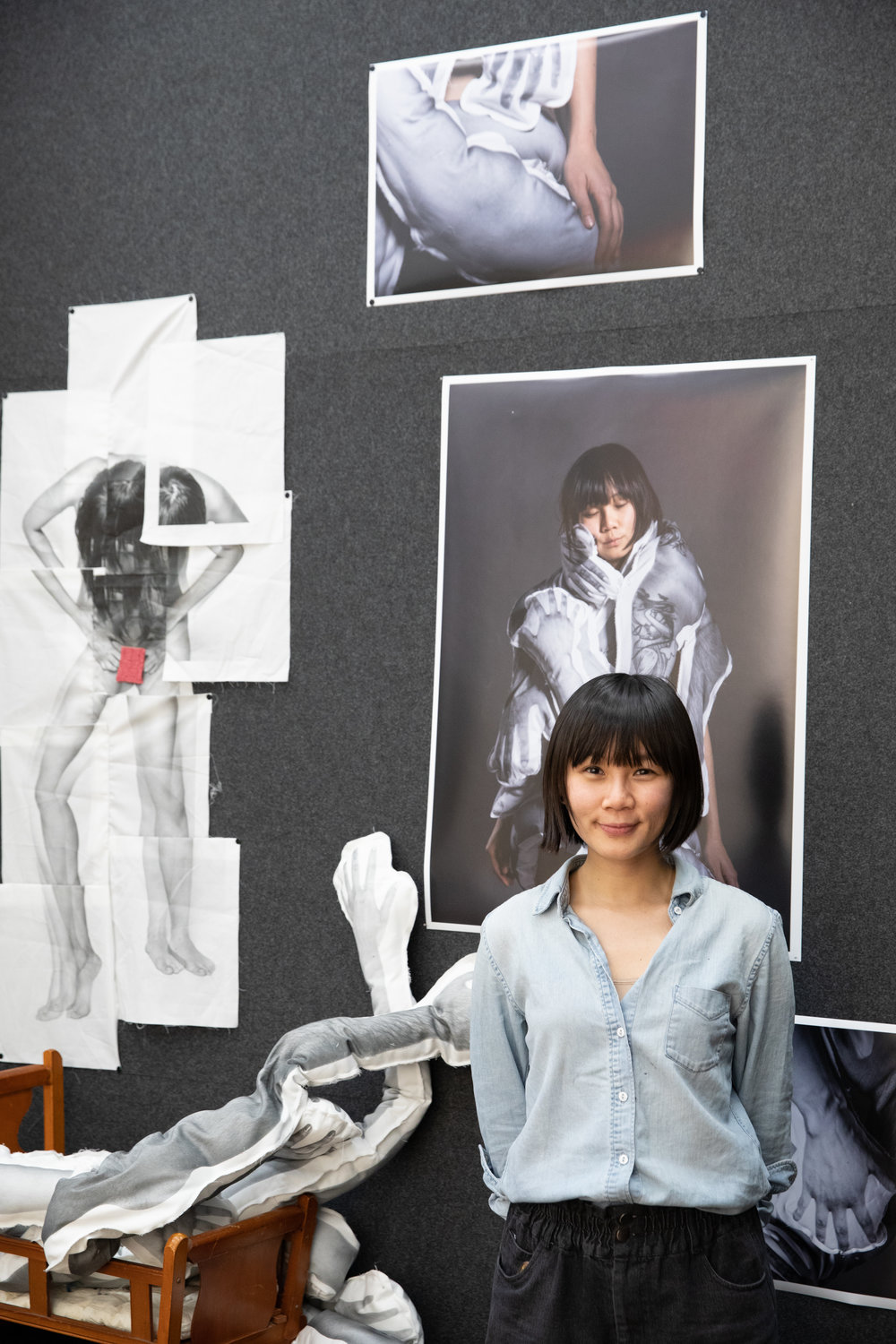 Yi Hsuan Lai (class of 2020) in front of a collection of her current works.
