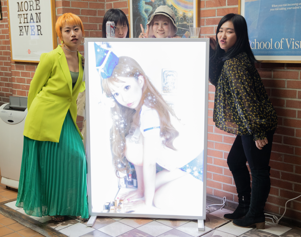 Class of 2018 students (From left to right):   Jing Lin ,  Lishan Liu ,  Dodo Xinyu Zhang  and Youwon Jeong standing beside an image from  Dodo Xinyu Zhang 's thesis.