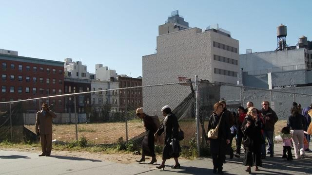 A wide shot of the vacant lot where Stacie is standing in Harlem in October 2008.