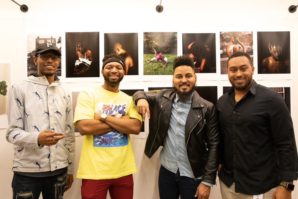 New student  Terrance Purdy  and friends with his selection of portraiture works.