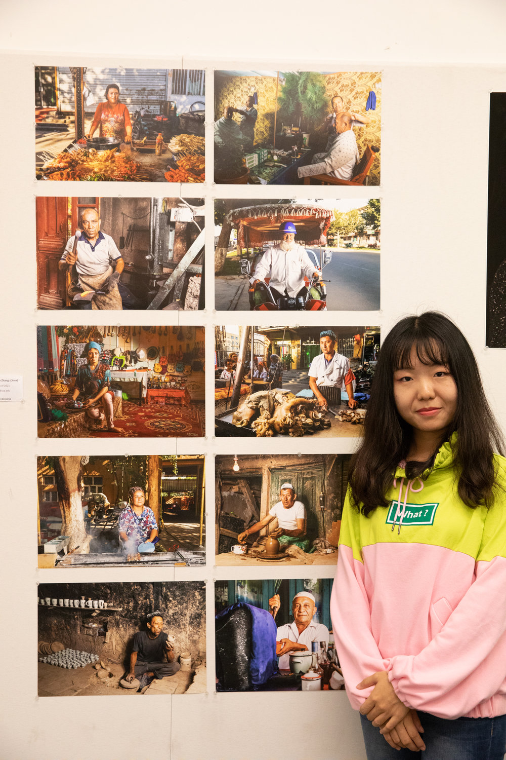 Yeshan Zhang beside her documentary portraiture.