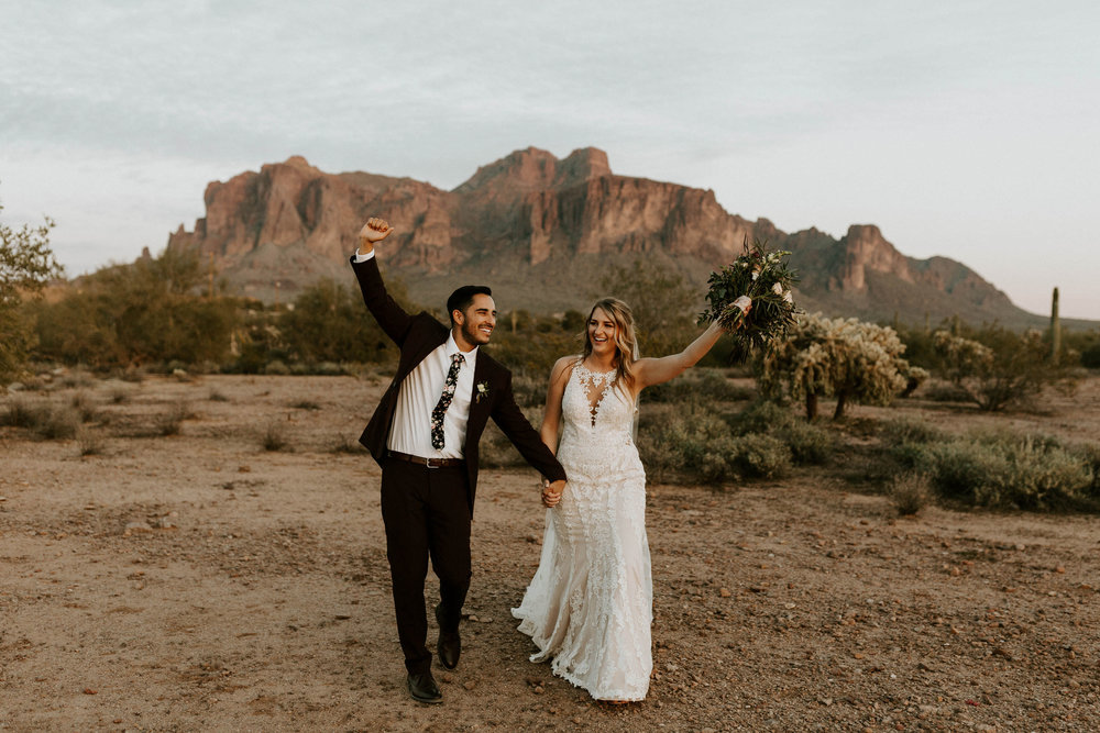 Bride and groom with Superstitious mountains in backdrop