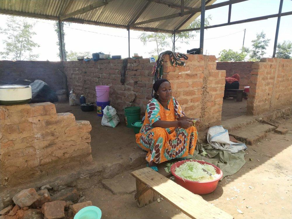 Mama Amina preparing food