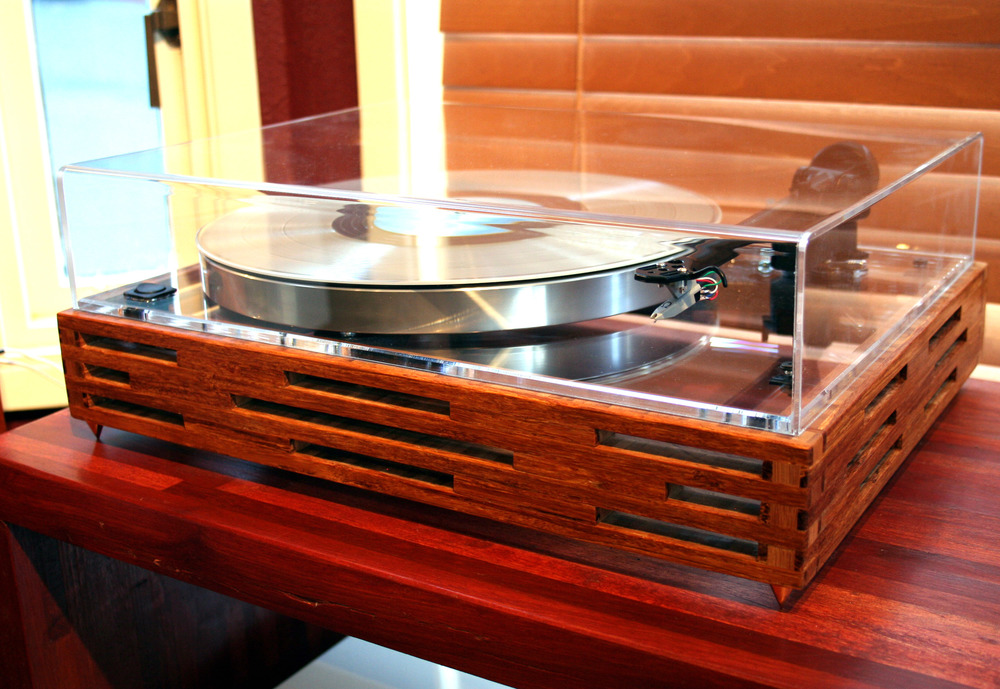 The Sunken Living Room Acoustic Research T-bar, platter, sub-platter, clear plexiglass top plate, Rega 202 tonearm, Hurst 300 motor, Ortofon 10 moving magnet cartridge, real bamboo custom built base, rocker on/off switch, 0.5 inch metal spikes, custom dust-cover.  SOLD.